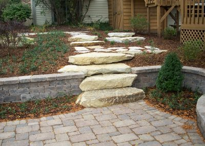 Outcropping stone to Patio